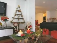 imagen Árbol de Navidad con troncos y cartón