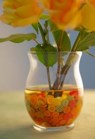 centro-de-mesa-con-rosas-y-botones
