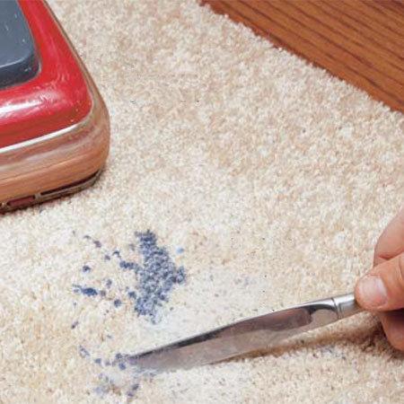 Manchas de cera en la alfombra 1