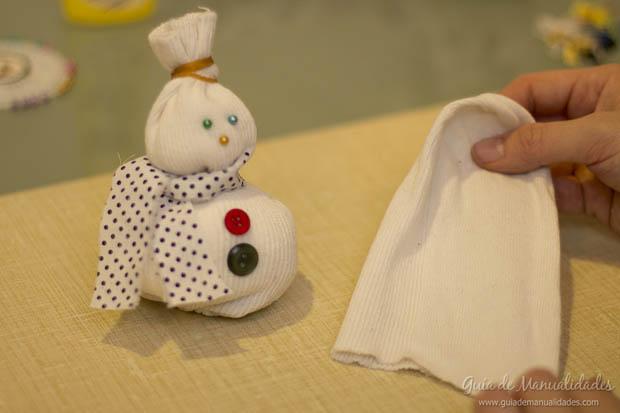 Muñeco navideño con medias 15