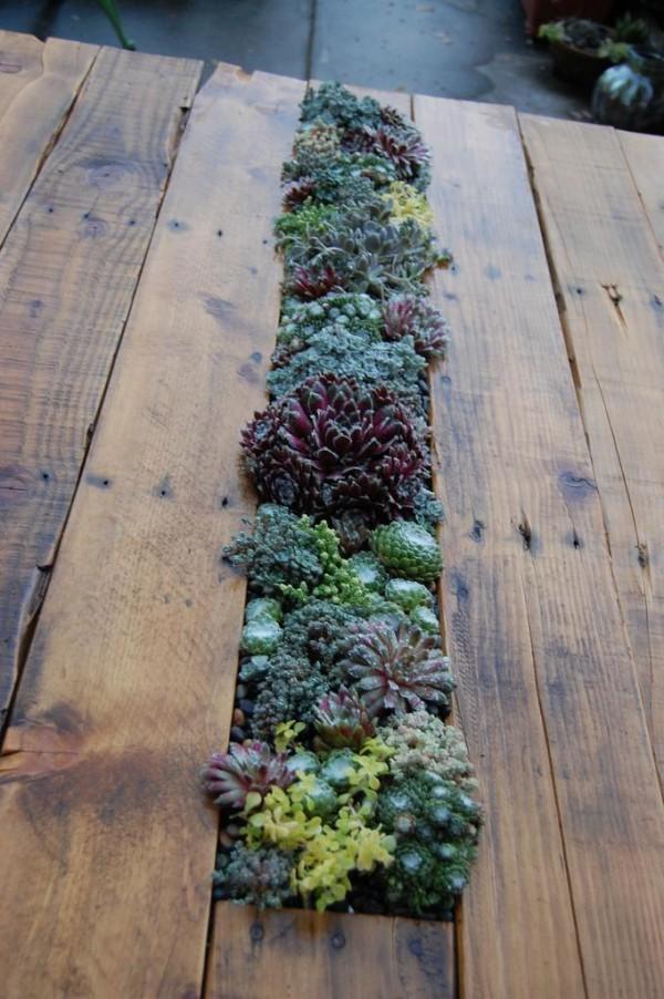 Mesa de palet con jardinería