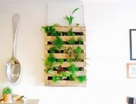 imagen Jardín vertical de interior con un palé