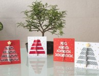 imagen Tarjetas de navidad con ramitas secas y cintas de diseño