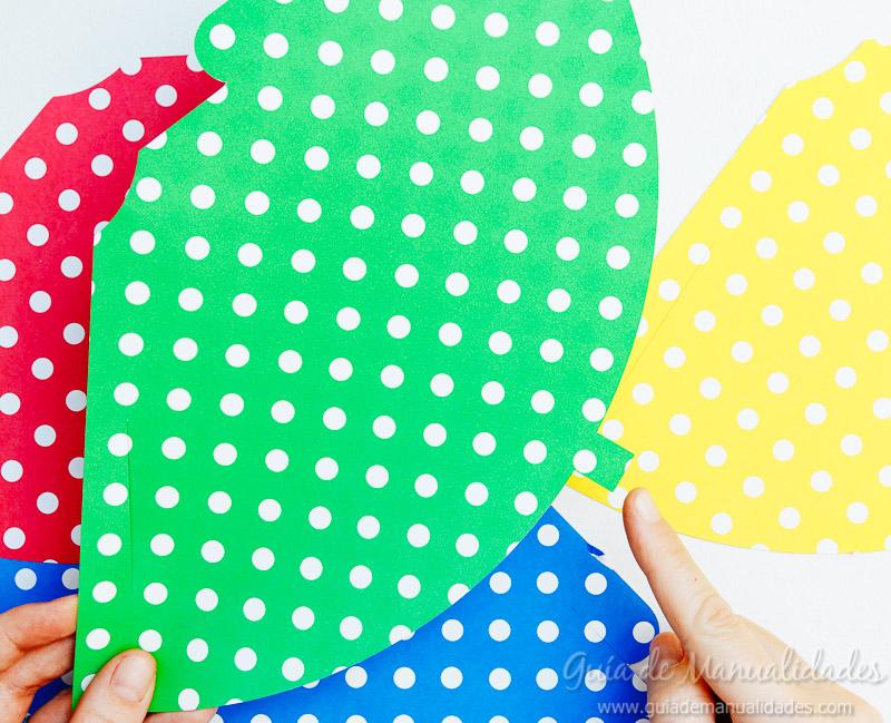 Gorros para fiestas con papel y pompones de lana - Guía de MANUALIDADES