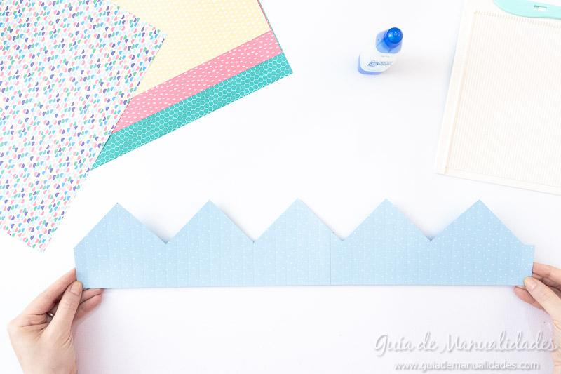 Cómo hacer una roseta estrella de papel 11