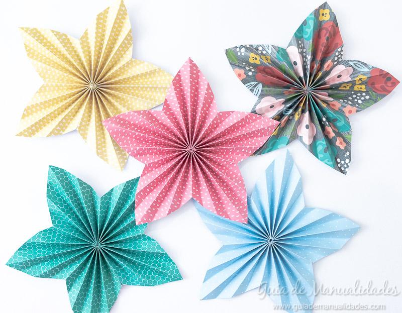 Cómo hacer una roseta estrella de papel 16