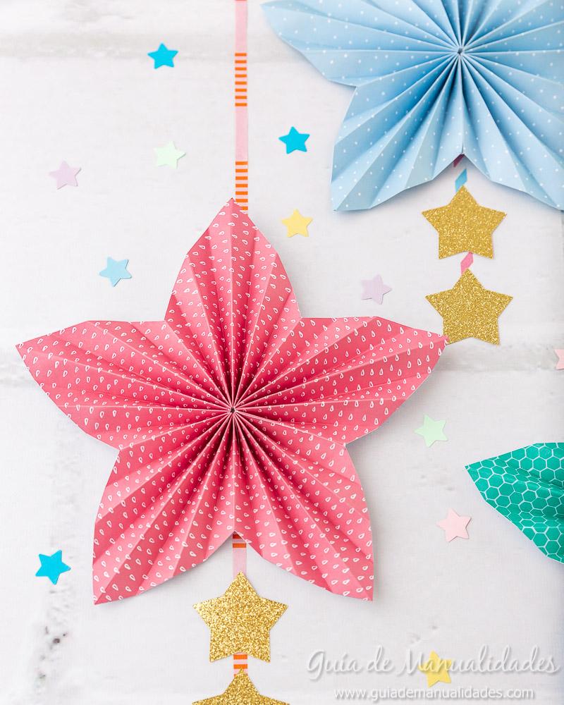 Cómo hacer una roseta estrella de papel 18