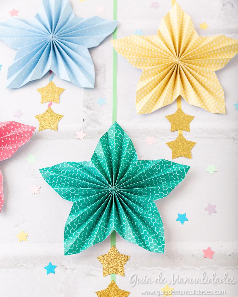 Cómo hacer una roseta estrella de papel 19