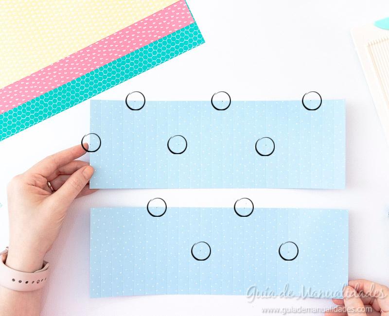 Cómo hacer una roseta estrella de papel 9